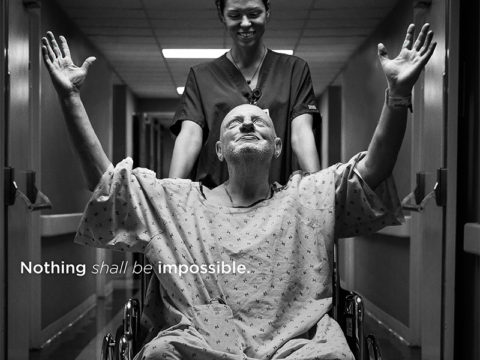 man in wheel chair praying from Saint Thomas Health traditional and digital healthcare marketing campaign Nashville TN